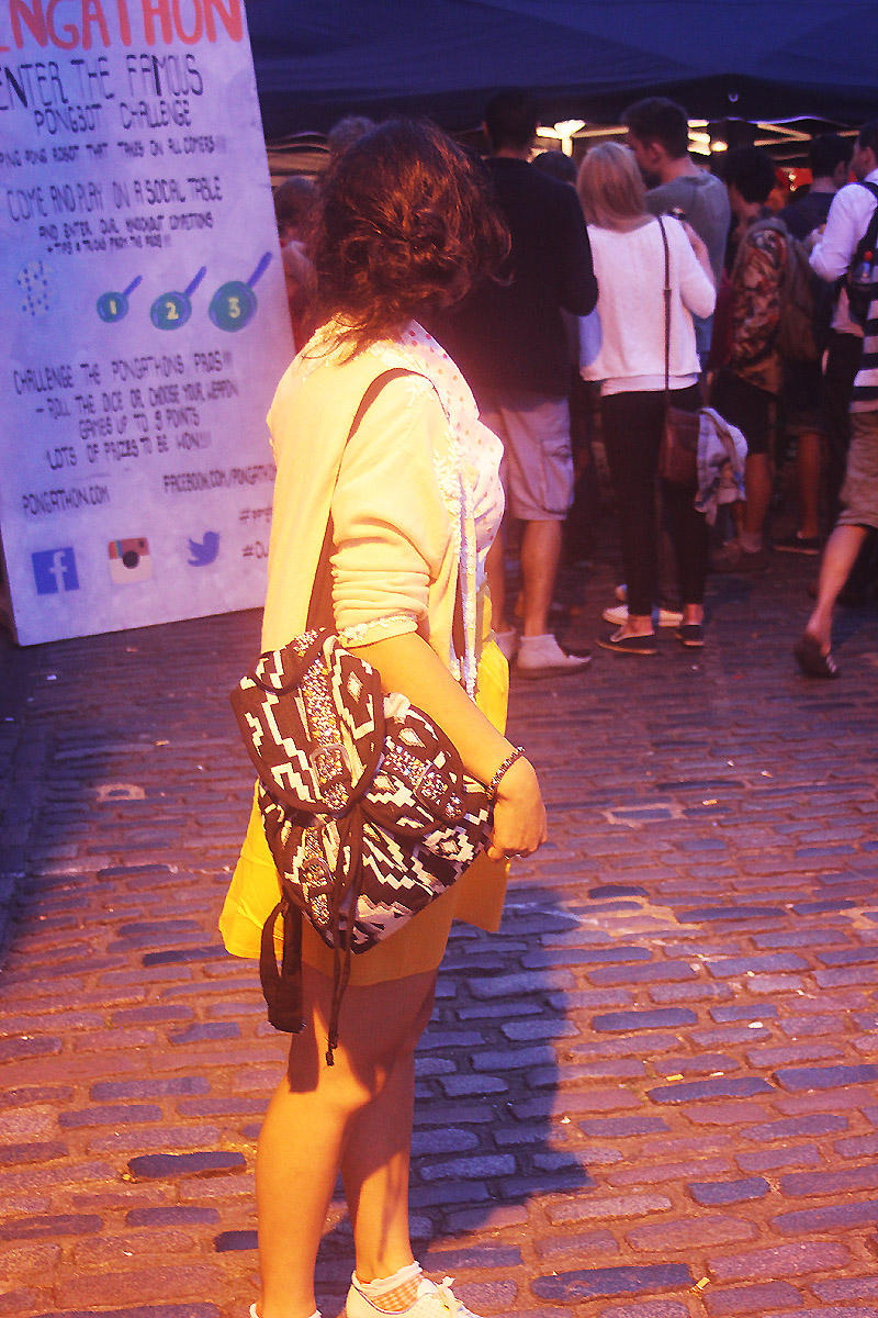 friends Camden lock yard stables market nightmarket night market clothes yellow skirt vintage cardigan denim cobbled brick street cobbles hanging out exterior london