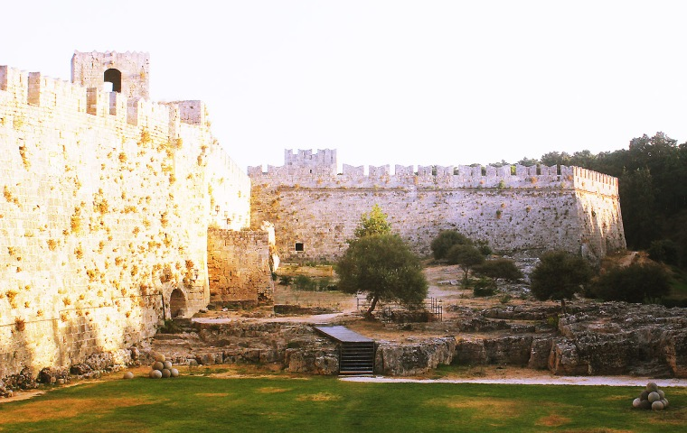 rhodes old town walls exterior cobble streets stone walls day light exterior old town
