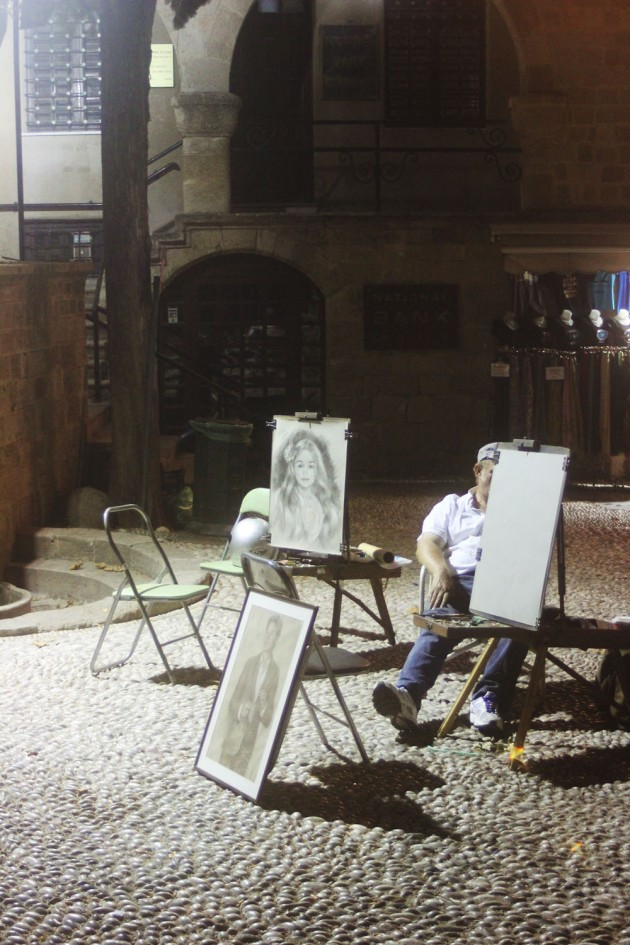 rhodes old town walls exterior cobble streets night painter artist street artist