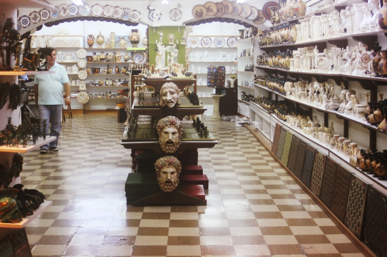 rhodes old town greece castle display shop ceramics statues bust