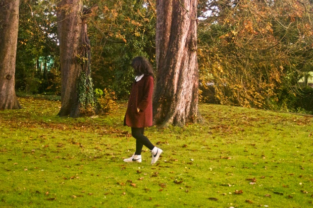 red burgundy swing coat oversize maroon accordion pleat white blouse new look nike trainers black bow outside garden exterior