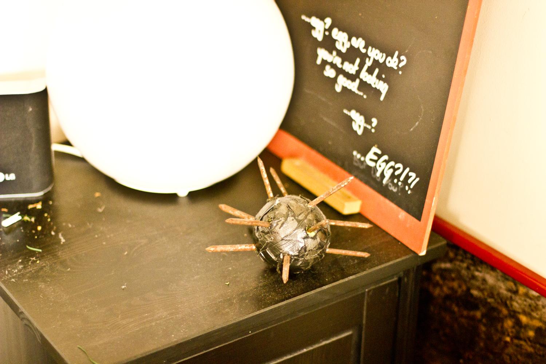 bommyknocker on desk by egg sign and lamp